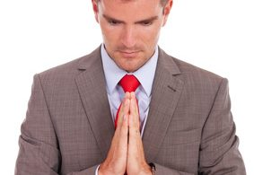 business man praying